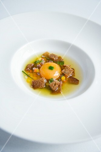 Prime boiled beef broth with egg, garlic bread and lovage