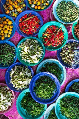 Edible flowers, aubergines, river algae and chillis at a market in Vientiane, Laos