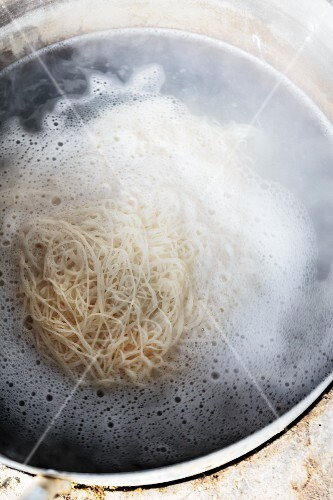 Fermented rice noodles being cooked, Vientiane, Laos
