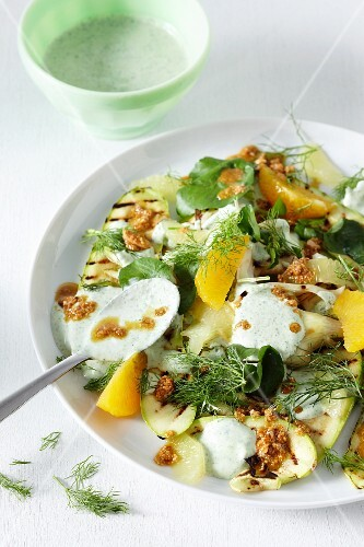 An autumnal vegetable salad with citrus fruits, herbs and a yoghurt dressing
