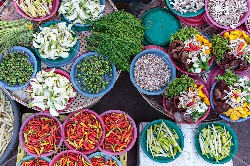 A colourful vegetable stand at a market in Vientiane, Laos