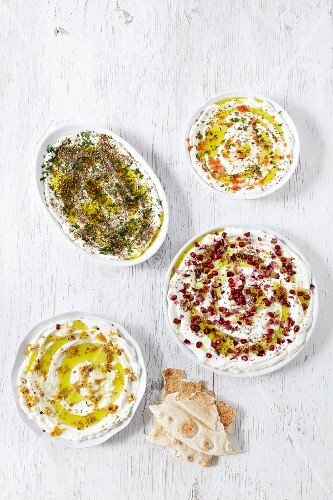 Four types of labneh with olive oil and unleavened bread