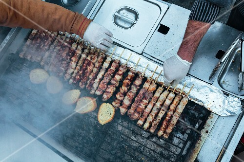 Pork skewers on a grill in Athens, Greece