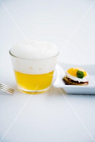 Asparagus cappuccino with a quail's egg canapé