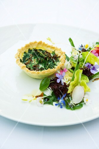 A mini stinging nettle tart with a wild herb salad
