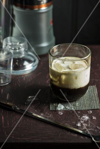 A White Russian cocktail with ice