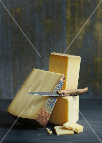 Blocks of Swiss cheese with a knife