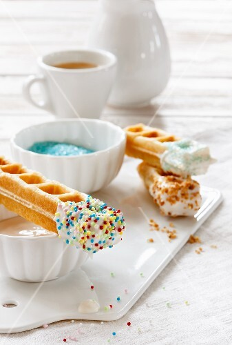 Waffle sticks with white chocolate and sugar sprinkles