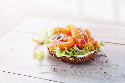 Half a wholemeal roll topped with smoked salmon, lettuce, onions and creamy horseradish