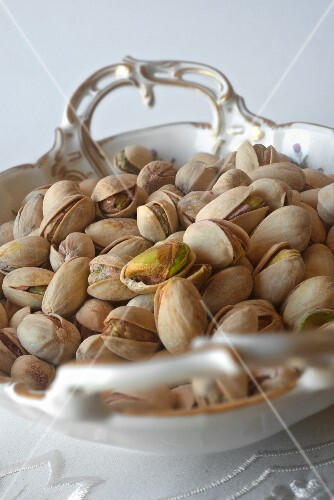 Pistachios in a porcelain bowl