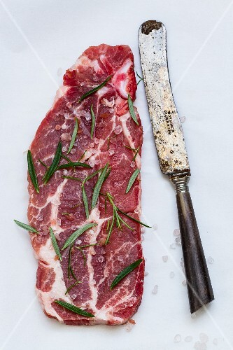 A slice of beef with rosemary
