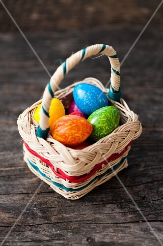 Colourful eggs in a basket for Easter