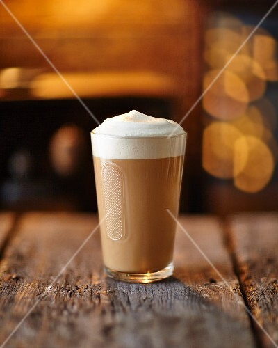 A Nescafe cappuccino on a rustic wooden surface