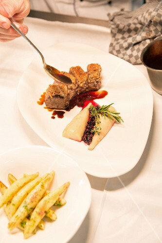 Marinated saddle of venison with a nut crust