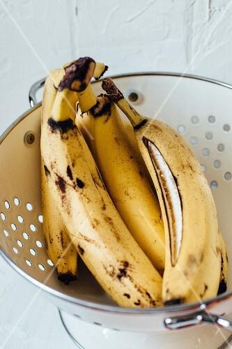 Overripe bananas in a colander