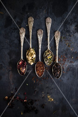 Various types of tea on five vintage spoons (seen from above)