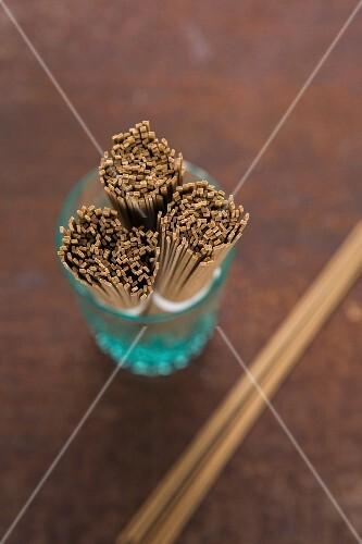 Bundles of ramen noodles in a glass