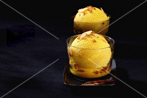 Mango ice cream with flaked almonds