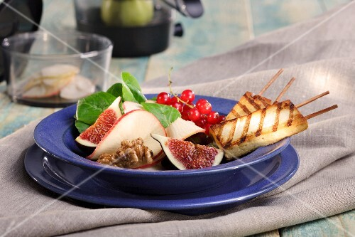 Apple and fig salad with mango vinaigrette and grilled tofu sticks