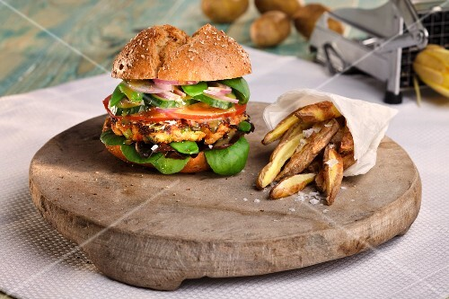 A veggie burger with potato wedges