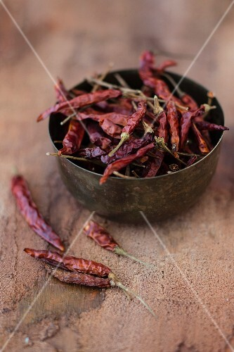 Dried chilli peppers in a metal bowl