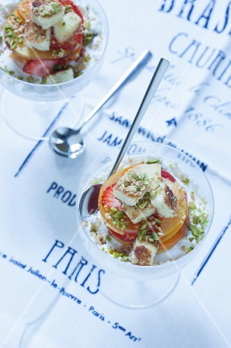 Ice cream with fresh fruit, croutons and pistachios