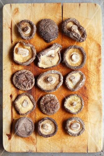 Dried shiitake mushrooms on a wooden board