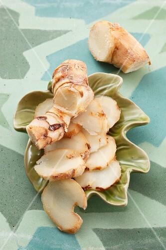 Sliced galganal on a leaf-shaped dish