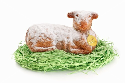 A baked Easter lamb on decorative grass