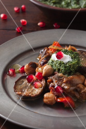 Aubergines with chickpeas, mint chutney and pomegranate seeds