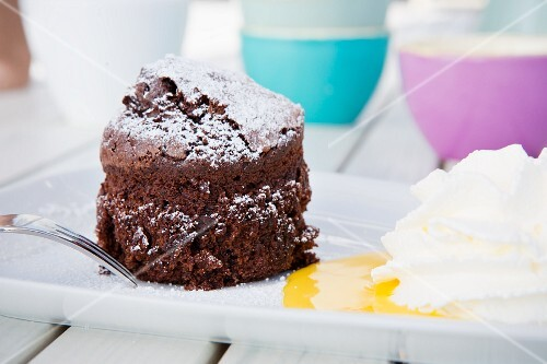 Chocolate cake with egg liqueur and whipped cream