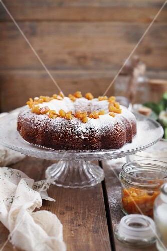 Citrus cake with icing sugar and candied orange peel