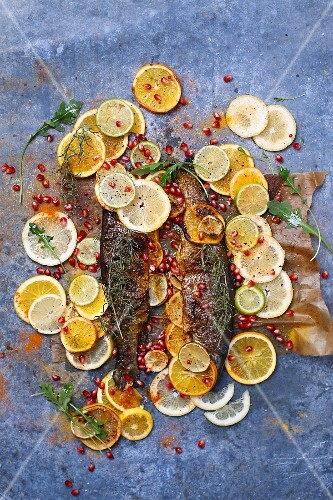 Oven-baked trout with oranges, lemons and limes