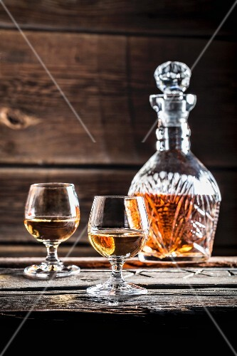 Two glasses of cognac and a carafe
