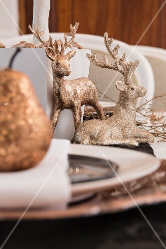 Christmas dinner table decorated with gold ornaments