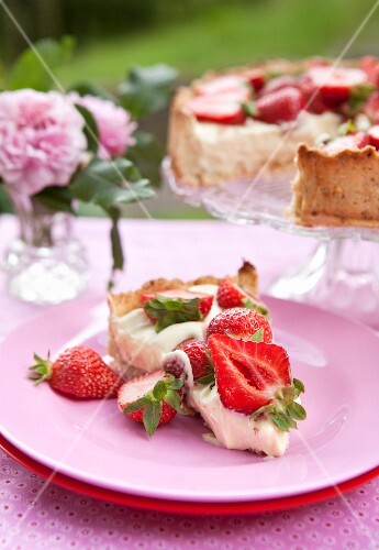 A slice of strawberry cake on a plate