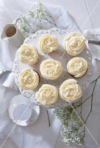 Cupcakes with a white cream topping