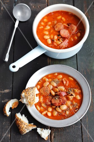 Stew with smoked pork belly, sausages, beans and tomatoes