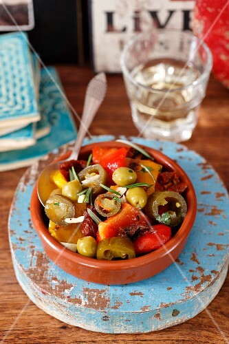 Grilled peppers with dried tomatoes, olives and jalapeños