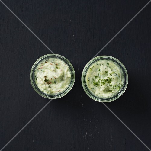 Cucumber raita and tzatziki in small bowls