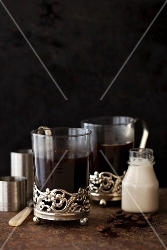 Black coffee with liqueur, coffee and a measuring jug