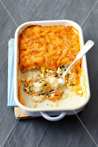 Cod and smoked fish bake with a curried potato topping