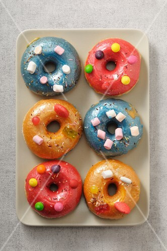 Colourful doughnuts decorated with marshmallows and chocolate beans
