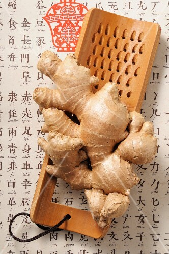 Fresh ginger on a wooden grater