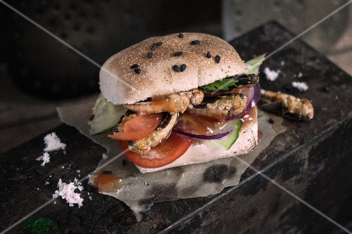 An insect burger with crickets