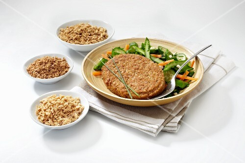 A vegetarian steak with salad and ingredients