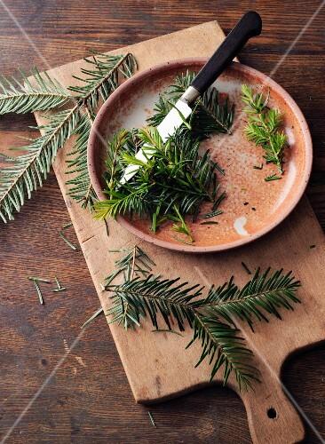 Pine sprigs and shoots being chopped for pine salve à la Hildegard von Bingen