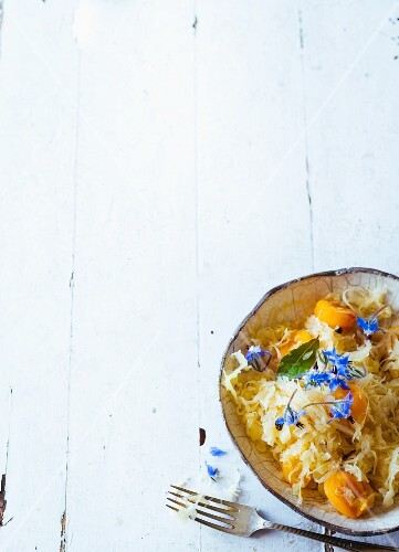 Braised sauerkraut with apricots and fresh broage flowers (Paleo)