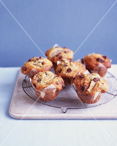 Banana chocolate muffins on a wire rack