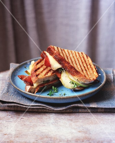 A toasted apple, bacon and cheese sandwich